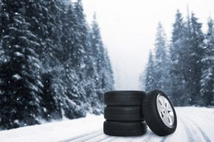 Set,Of,Wheels,With,Winter,Tires,Outdoors,On,Snowy,Road